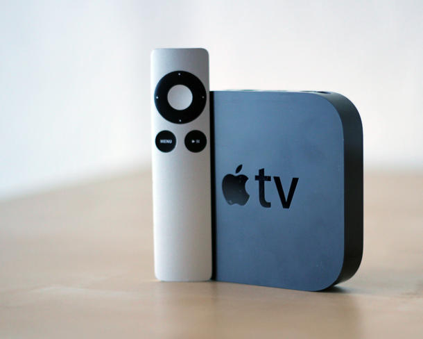 Apple TV standing with Remote